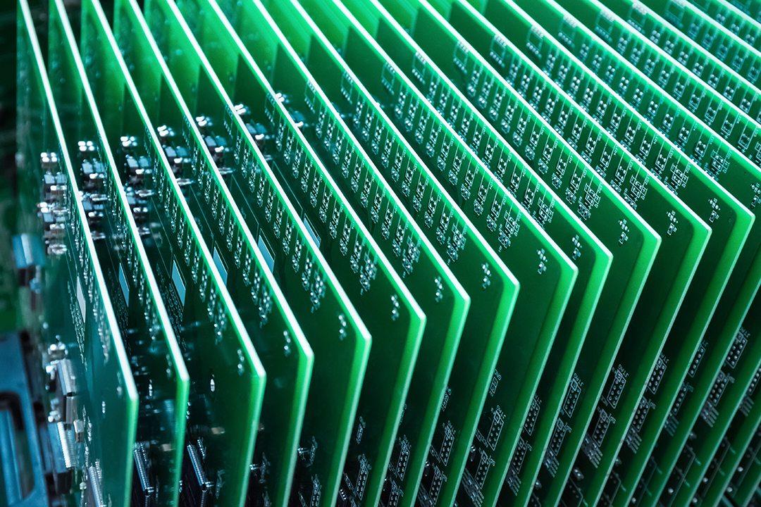 a-row-of-green-circuit-board-P7KUAYA
