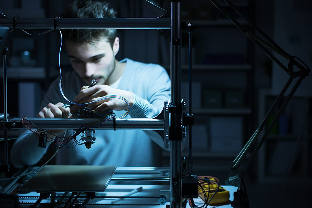 young-engineer-working-on-a-3d-printer-PVFF4L5